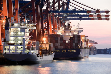 cargo ships in harbor loading freight containers
