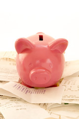 piggy bank in a pile of bills