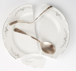 Broken plate and bent silverware