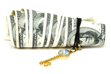 golden key and dollars isolated on white