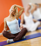 Fototapety Group of people doing yoga exercise