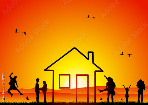 Happy people with house at sunset