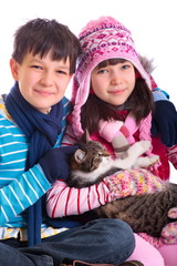 Boy and girl holding cat
