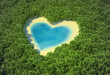 Heart-shaped pond in a tropical forest - 12448176