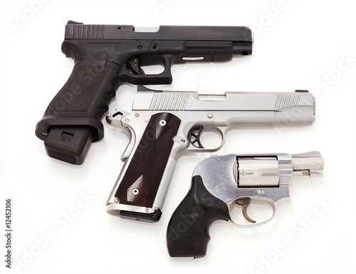 Three pistols on white background