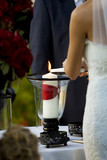Lighting the Unity Candle during Wedding Ceremony poster