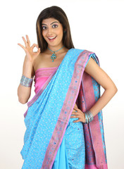female with blue sari saying excellent