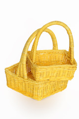 Two nice yellow wicker baskets isolated on white background