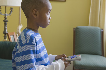 Small boy playing with the remote