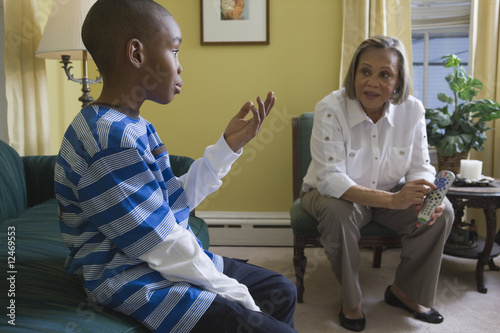 Boy talking to his grandmother about the remote