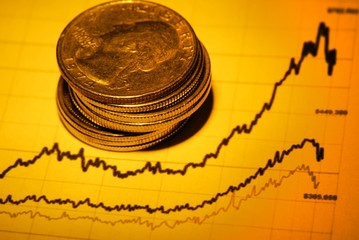coins and financial graph