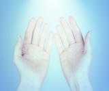 hands receiving healing energy poster