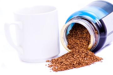 Coffee granules and mug.