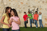 group of adolescents kids interacting and whispering poster