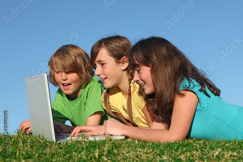 group of kids or children with laptop outdoors