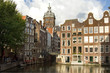 Church and merchant houses along the canal in Amsterdam