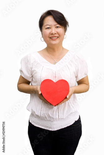 Asian lady posing with heart shape gift box