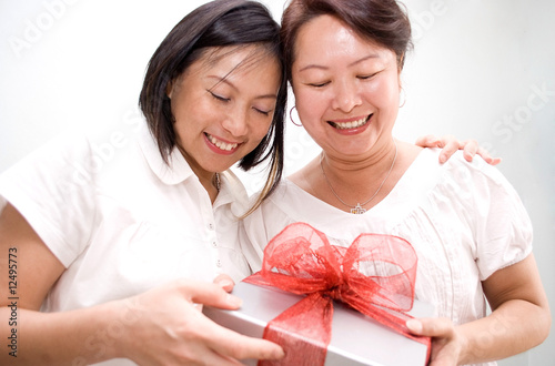 lady giving gift and hug