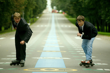 Two Young Men With Rollerblades