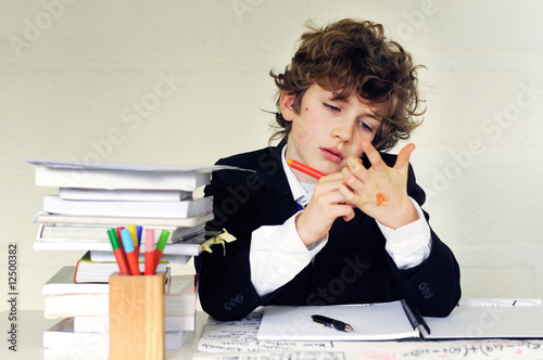 school boy writing on his hand