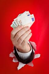 Hand holding Euro
