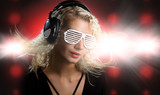 Beautiful young woman with headphones in nightclub poster