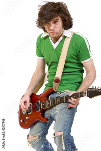 passionate headbanging guitarist playing his electric guitar