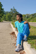 Indian teenage jogger resting