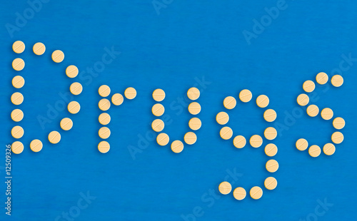 The word drugs spelled out with pills