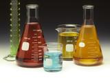 Scientific glassware filled with colored liquids poster
