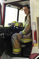 Fire lieutenant sitting in fire truck