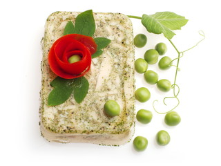 Aspic from bird decorated with tomato flower and green pea...