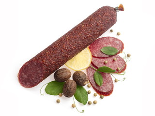 Smoked salami decorated with lemon, walnuts, pepper...