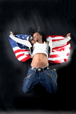 afro-american dancer in jump with USA flag against black backgro