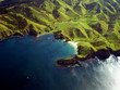 Wrinkled Green Hills of New Zealand Coastline