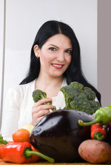 Woman with broccoli and vegetables