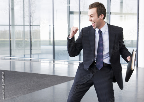A successful businessman making a triumphal gesture
