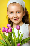 smiling beautiful  young girl with flowers at spring
