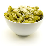 Rigatoni pasta and basil pesto with grated parmesan cheese