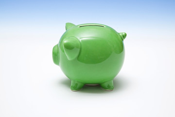 Green piggy bank style money box.