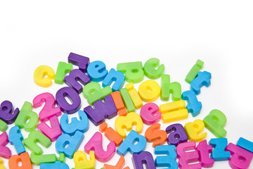 Magnetic letters isolated on a white studio background.