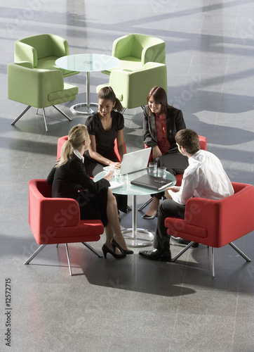 A group of four business colleagues holding an informal meeting