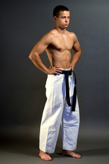 Young sporty karate man waiting  special exercise
