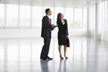 A letting agent showing businesswoman around an empty office