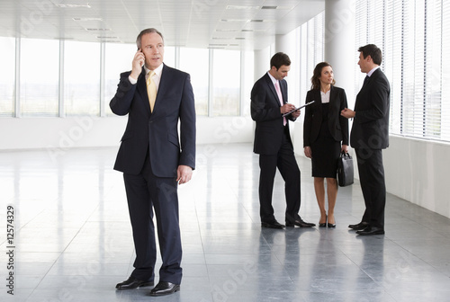 A letting agent showing business people around empty office