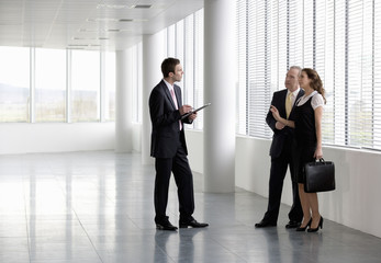 A letting agent showing businesspeople around an empty office