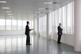 A letting agent showing a businessman around an empty office