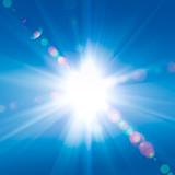 Fototapety Sun rays against a blue sky