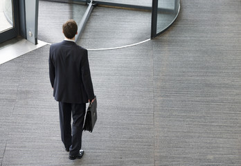 A businessman leaving office