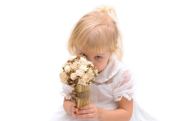 little girl sniffing  flowers